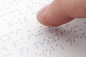Finger reading braille