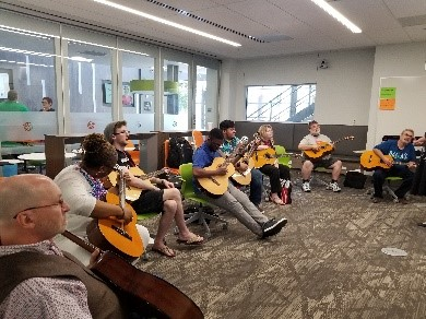 Teachers playing guitars together